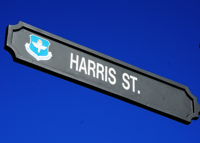 """Carlyle Harris Street, formerly """"D Street"""", was named after Carlyle """"Smitty"""" Harris, a United States Air Force Pilot. Harris was a Prisoner of War in Vietnam for nearly eight years before being rescued. After a short recovery period, he continued his Air Force career attaining the rank of colonel when he retired."""