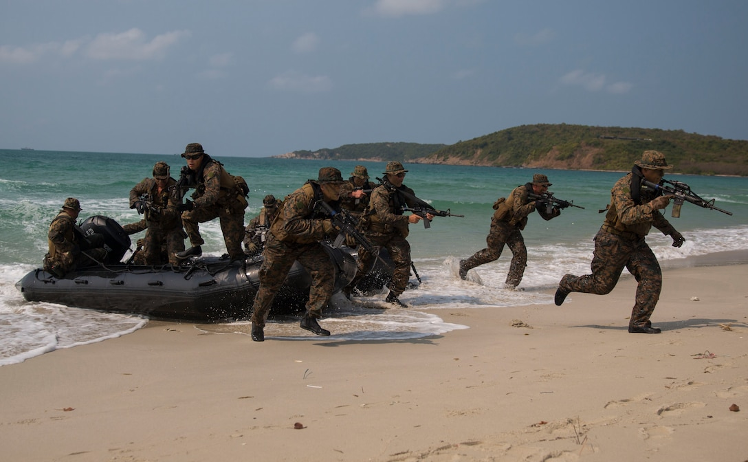 U.S. Marines infiltrate the beach head as part of an amphibious demonstration at Hat Yao Beach, Kingdom of Thailand, during Cobra Gold 2014, Feb. 14. Working together and conductint joint and multinational training is vital to maintaining the readiness and interoperability of the Thai, U.S. and other participating military forces. The Marines were with 3rd Reconnaissance Battalion, 3rd Marine Division, III Marine Expeditionary Force.