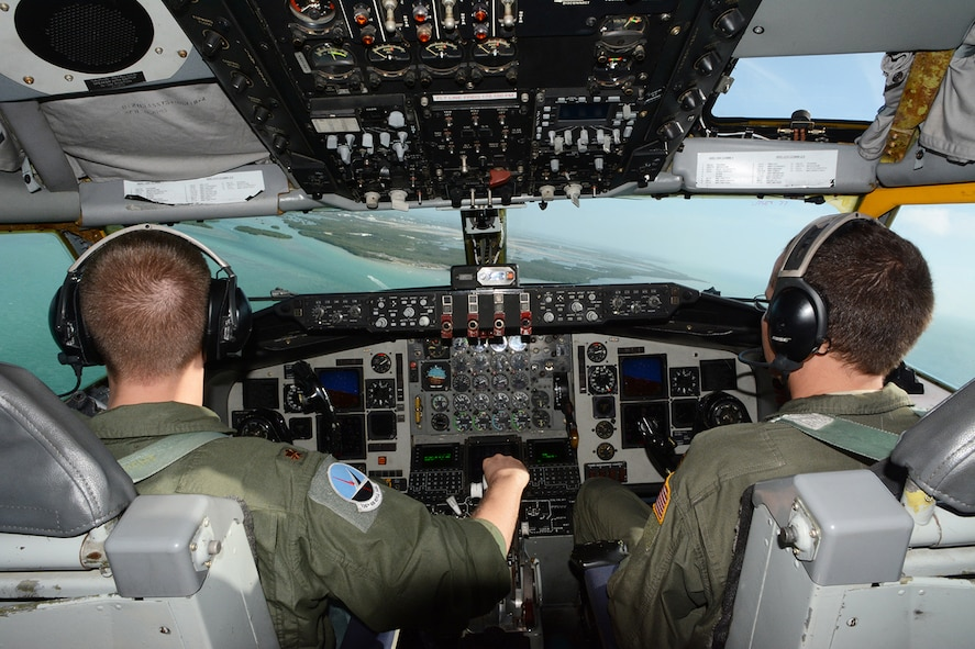 Maj. Mike Dirnberger, 128th Air Refueling Wing pilot, and Maj. Robert Ulander, 128th ARW co-pilot, prepare the KC-135 Stratotanker for a landing onto Naval Air Station Key West, Key West, Fla., Feb. 5, 2014. The pilots and their crew allowed Airmen assigned to the 115th Fighter Wing an incentive ride so they could watch an air refueling live. (Air National Guard photo by Senior Airman Andrea F. Liechti)
