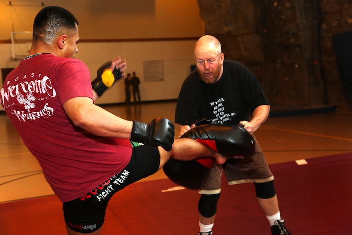 Sgt. Daniel Ramirez trains with Larry Rabiscotti, head coach, at the Marine Corps Mountain Warfare Training Center in Bridgeport, Calif., Feb. 3, 2014. Ramirez is currently ranked 14th worldwide in the ISCF league and plans to go pro.