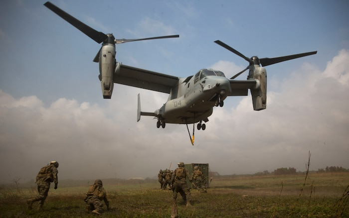 Royal Thai and U.S. Marines begin to load the shipping container to the MV-22B Osprey at Utaphao, Kingdom of Thailand Feb. 17 during Exercise Cobra Gold 2014. Thailand and the United States are committed to working together in areas of common interest for the betterment of regional security. Our long-standing alliance and partnership continues to grow and strengthen. The U.S. Marines are Landing Support Specialists with Combat Logistics Battalion 4, Combat Logistics Regiment 3, 3rd Marine Logistics Group. The Royal Thai Marines are shore management with Landing Force Company, Support Regiment, Marine Corps Division.