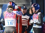 U.S. Army World Class Athlete Program and Team USA luge coach Staff Sgt. Bill Tavares, center, talks with Sgt. Preston Griffall, and Sgt. Matt Mortensen, left, before the first heat of the Olympic luge doubles event Feb. 12, 2014, in Krasnaya Polyana, Russia. U.S. Army photo by Tim Hipps