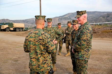 Brig. Gen. Carl E. Mundy, commanding general of 1st Marine Expeditionary Brigade, greets Lt. Gen. John A. Toolan, commanding general of I Marine Expeditionary Force, at the gate of a MEB command post during an exercise aboard Camp Pendleton, Calif., Feb. 11. Toolan toured the command operations center and other elements of the Brigade Headquarters Group supporting the needs of the MEB.