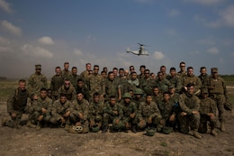Royal Thai and U.S. Marines pose for a group photo at Utaphao, Kingdom of Thailand Feb. 17 during Exercise Cobra Gold 2014. Thai and U.S. relationship is strong and very important to both countries providing a solid foundation for continued regional peace and security. The U.S. Marines are Landing Support Specialists with Combat Logistics Battalion 4, Combat Logistics Regiment 3, 3rd Marine Logistics Group. The Royal Thai Marines are shore management with Landing Force Company, Support Regiment, Marine Corps Division.