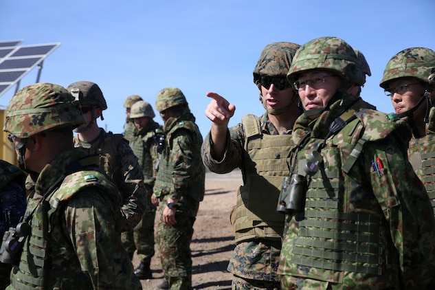 U.S. Marine Lt. Col. Bill Wischmeyer, executive officer, 15th Marine Expeditionary Unit, speaks with Maj. Gen. Hiroaki Kawamoto, deputy chief of staff (operations), Western Army, Japan Ground Self-Defense Force during Exercise Iron Fist 2014 aboard San Clemente Island, Calif., Feb. 13, 2014. Iron Fist is an amphibious exercise that brings together Marines and sailors from the 15th MEU, other I Marine Expeditionary Force units, and soldiers from the JGSDF, to promote military interoperability and hone individual and small-unit skills through challenging, complex and realistic training. (U.S. Marine Corps photo by Lance Cpl. Ricardo Hurtado/Released)