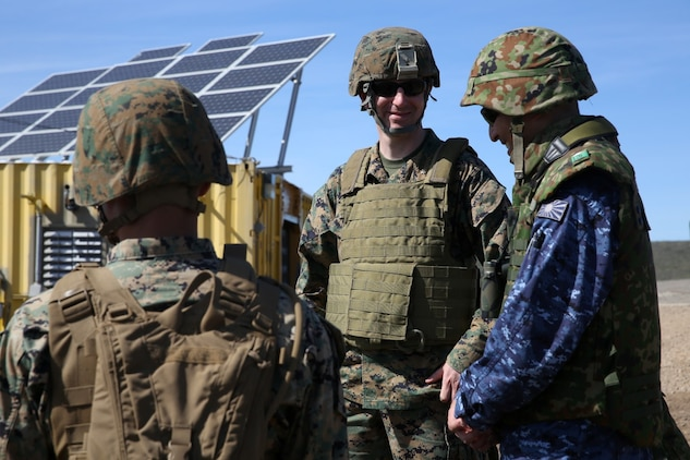 U.S. Marine Maj. Paul Bartok, middle, Marine liaison to the Western Army Infantry Regiment, Japan Ground Self-Defense Force, speaks with officials of the JGSDF during Exercise Iron Fist 2014 aboard San Clemente Island, Calif., Feb. 13, 2014. Iron Fist is an amphibious exercise that brings together Marines and sailors from the 15th Marine Expeditionary Unit, other I Marine Expeditionary Force units, and soldiers from the JGSDF, to promote military interoperability and hone individual and small-unit skills through challenging, complex and realistic training. (U.S. Marine Corps photo by Lance Cpl. Ricardo Hurtado/Released)