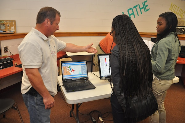 Mike Ansley, a member of the survey team for the U.S. Army Corps of Engineers Savannah District, explains how the Corps uses computer equipment to survey land during a visit to Jenkins High School, Feb. 13, 2014. The visit aimed to recruit students to pursue science and engineering related career paths as part of National Engineers Week.