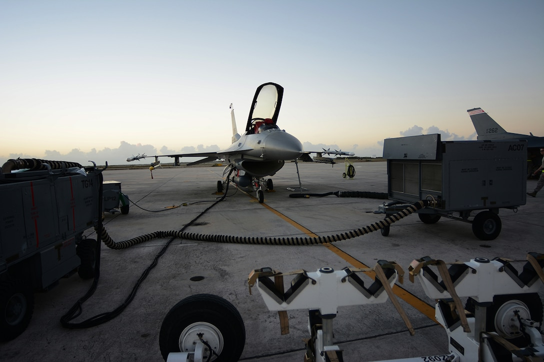 An Air National Guard F-16 Fighting Falcon assigned to the 115th Fighter Wing receives maintenance on the Navy Air Station Key West flightline, Key West, Fla., Feb. 4, 2014. The 115th FW came to Key West in February to reduce the likelihood of flight cancelations due to weather. The deployment allowed pilots to test their expertise against dissimilar aircraft. (Air National Guard photo by Senior Airman Andrea F. Liechti)