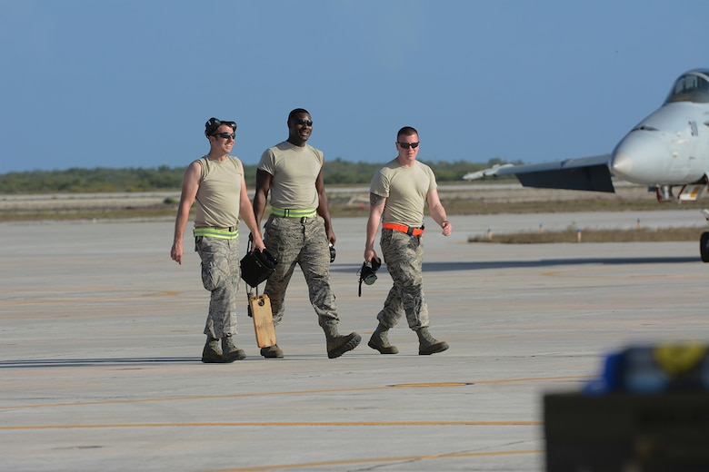 Airmen assigned to the 115th Fighter Wing exit the flightline after helping taxi an F-16 Fighting Falcon to the runway during a training exercise near Key West, Fla., Feb. 3, 2014. The 115th FW came to Key West in February to reduce the likelihood of flight cancelations due to weather. The deployment allowed pilots to test their expertise against dissimilar aircraft. (Air National Guard photo by Senior Airman Andrea F. Liechti)