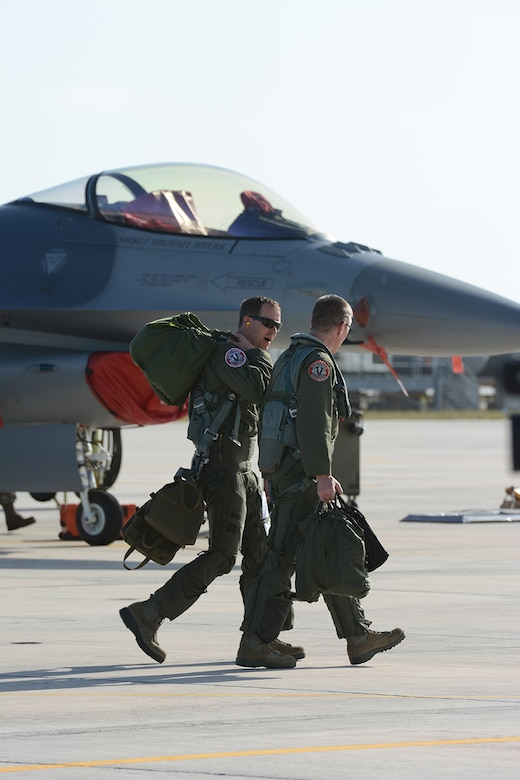 Pilots assigned to the 115th Fighter Wing exit the Naval Air Station Key West following a training exercise near Key West, Fla., Feb. 3, 2014. The 115th FW came to Key West in February to reduce the likelihood of flight cancelations due to weather. The deployment allowed pilots to test their expertise against dissimilar aircraft. (Air National Guard photo by Senior Airman Andrea F. Liechti)