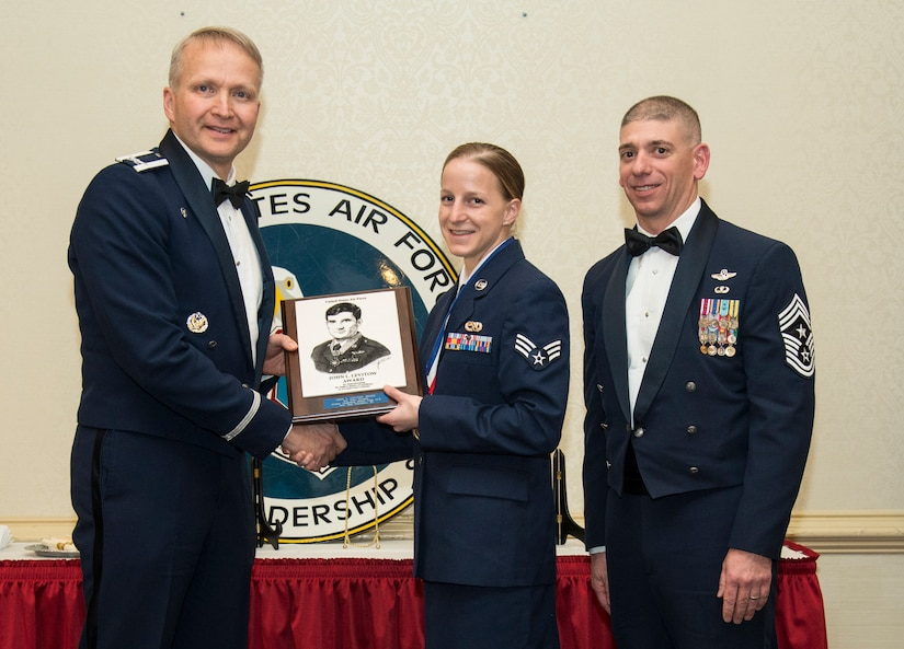 Col. Darren Hartford, 437th Airlift Wing commander, and Chief Master Sgt. Shawn Hughes, 437th AW command chief, present Senior Airman Ellen Gruesen, 437th Maintenance Squadron journeyman, the John Levitow Award during the Airman Leadership School Class 14-B graduation ceremony Feb. 2, 2014, at JB Charleston – Air Base, S.C. The Levitow Award is awarded for a student's exemplary demonstration of excellence, both as a leader and scholar. (U.S. Air Force photo/ Airman 1st Class Clayton Cupit)