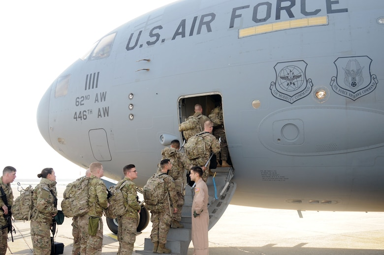 MIHAIL KOGALNICEANU AIR BASE, Romania - Servicemembers board a C-17 bound for Afghanistan. After more than a decade of operations at Manas, Kyrgystan, the Romanian location has become the U.S. military's main air hub for passengers and cargo into and out of Afghanistan.
