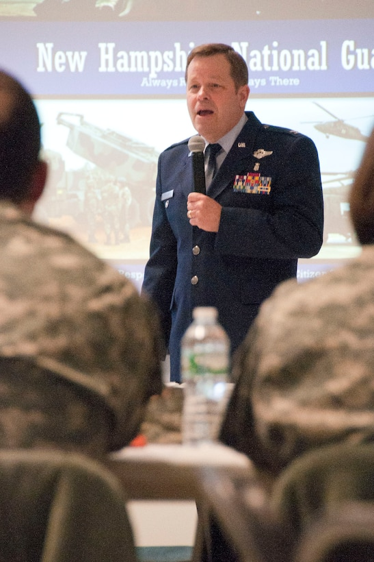 Air Force Col. Brett Wyrick, joint deputy surgeon, addresses an audience of N.H. Army and Air National Guard medical professionals during a N.H. Medical Symposium Feb. 9, 2014, Pease Air National Guard Base, Portsmouth, N.H. The Medical Symposium brought together senior leaders of the organization along with the medical staff from the Army and Air to build a shared understanding and to develop a way ahead for enhanced medical training, education and missions. (N.H. Air National Guard photo by Airman 1st Class Kayla McWalter/RELEASED)