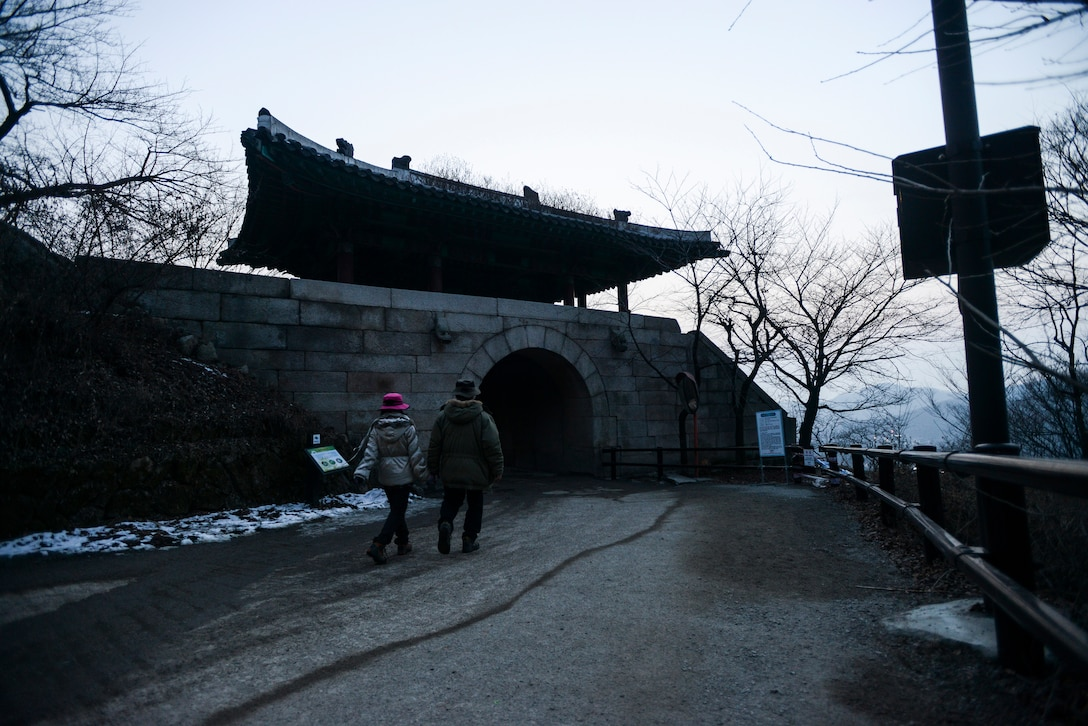 A couple walk under one of the manmade archways in Bukhansan National Park Feb. 16, 2014, in Seoul, Republic of Korea. Bukhansan is nearly 80 kilometers large, and home to the Bukhansanseong Fortress, an ancient defensive structure designed to protect Korea from potential advesaries. (U.S. Air Force photo by Staff Sgt. Jake Barreiro)
