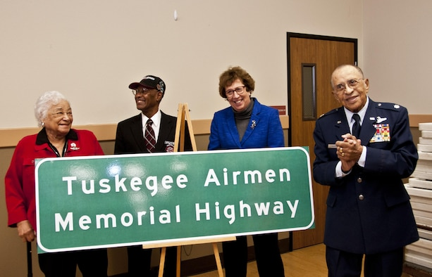 Lt. Col. (ret.) James Warren, Senator Lois Wolk, Aubrey Matthews and Edith Roberts proudly present the Tuskegee Airmen Memorial Highway sign that will be displayed on Interstate 80 Feb. 6 at the Veterans Hall in Dixon, Ca. (U.S. Air Force photo/Senior Airman Madelyn Brown)