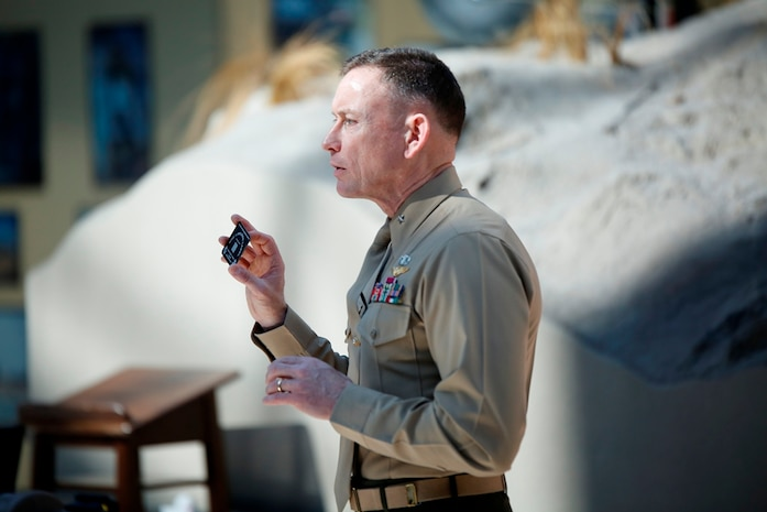 Brig. Gen. Frank Kelley, commander of Marine Corps Systems Command, displays an item unique identification marking that will be attached to an M32A1 multi-shot grenade launcher Feb. 18 at the National Museum of the Marine Corps in Triangle, Va. This was the 1 millionth IUID placed on an item for the Marine Corps.