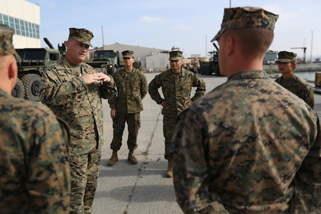 U.S. Marine Corps Col. Kurt A. Kempster Commanding Officer Combat Logistics Regiment 1 (CLR-1), speaks with junior Marines about their experiences during exercise Brilliant Scepter aboard Naval Amphibious Base Coronado, Coronado, Calif., February 18, 2014. Marines from CLR-1, Combat Logistics Battalion 5, and 7th Engineer Support Battalion worked along side naval units to conduct Maritime Prepositioning Force (MPF) training in preparation for their upcoming deployment to Jordan as part of Operation Eager Lion. MPF's serve as a naval power projection capability that supports the deployment and employment of Naval and Marine forces worldwide.