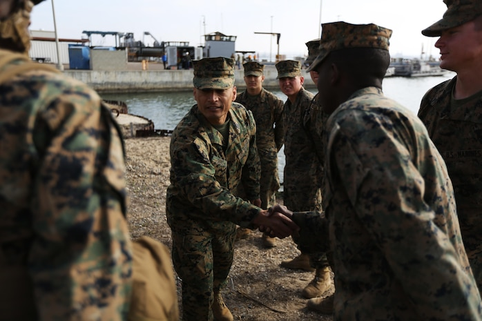 U.S. Marine Corps Sgt. Maj. Juan J. Diaz, Sergeant Major Combat Logistics Regiment 1 (CLR-1), speaks with junior Marines about their experiences during exercise Brilliant Scepter aboard Naval Amphibious Base Coronado, Coronado, Calif., February 18, 2014. Marines from CLR-1, Combat Logistics Battalion 5, and 7th Engineer Support Battalion worked along side naval units to conduct Maritime Prepositioning Force (MPF) training in preparation for their upcoming deployment to Jordan as part of Operation Eager Lion. MPF's serve as a naval power projection capability that supports the deployment and employment of Naval and Marine forces worldwide.