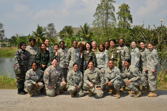 Participants in the first international Sisters in Arms, which took place during Cobra gold 2014, pose for a photo.