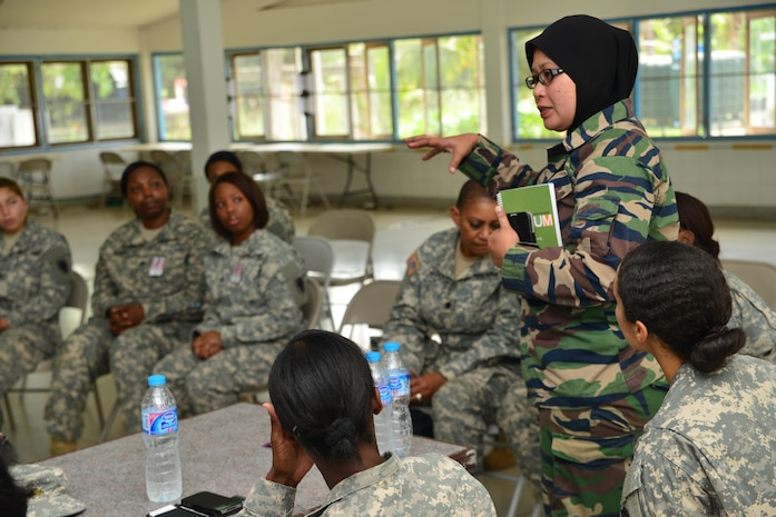 Lieutenant Col. Salawati Yahaa, an officer from the Malaysian Joint Force Headquarters, shared her experience with prioritizing and balancing from the perspective of being both a mother of four while continuing to serve her country at the first international Sisters in Arms during Cobra Gold 2014.