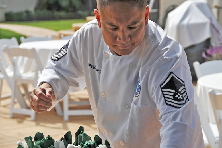 Master Sergeant Jessie Gregorio Master Sergeant Jessie Gregorio puts the finishing touches on food to be served at a party. (Photo by Sarah Corrice) (Photo by Sarah Corrice)