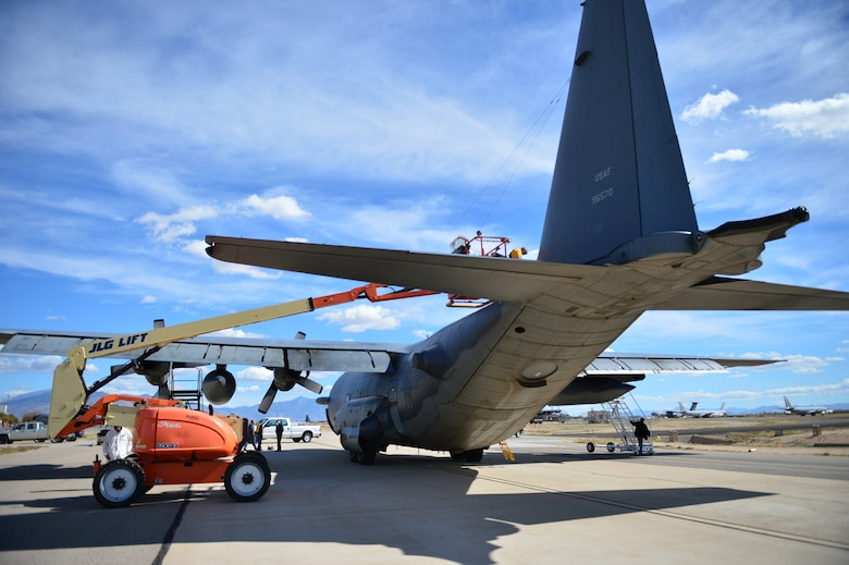 "Personnel from the 309th Aerospace Maintenance and Regeneration Group begin prepping the AC-130H Spectre gunship ""Bad Company"" for transport to the boneyard at Davis-Monthan Air Force Base, Ariz., Feb. 7, 2014. Bad Company will remain at the boneyard until it is either scrapped and used for parts or regenerated and put back into the air. (U.S. Air Force photo/ Senior Airman Eboni Reece)"