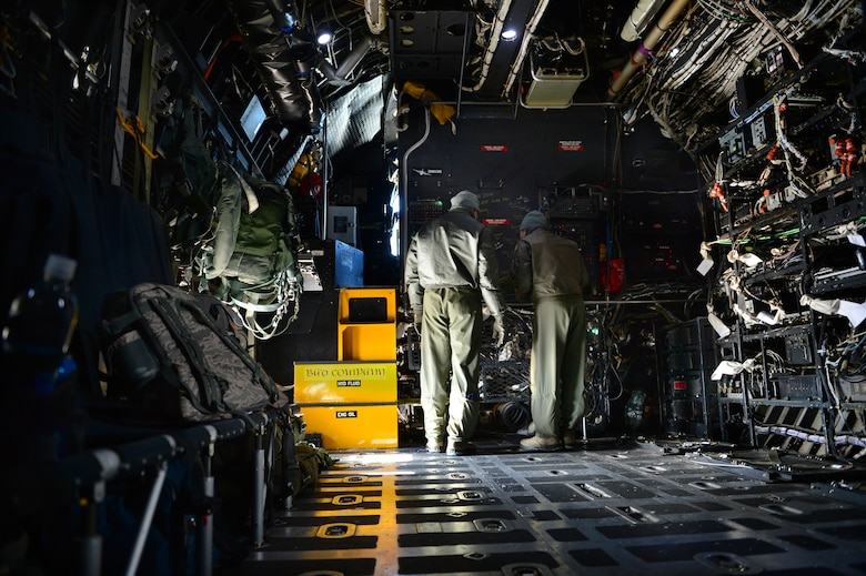 "Two aircrew members with the 16th Special Operations Squadron review flight plans aboard the AC-130H Spectre gunship ""Bad Company"" at Cannon Air Force Base, N.M., Feb. 7, 2014. Built in 1969, Bad Company is the first of six Spectre gunships scheduled to make the trip to Davis-Monthan Air Force Base, Ariz. (U.S. Air Force photo/ Senior Airman Eboni Reece)"