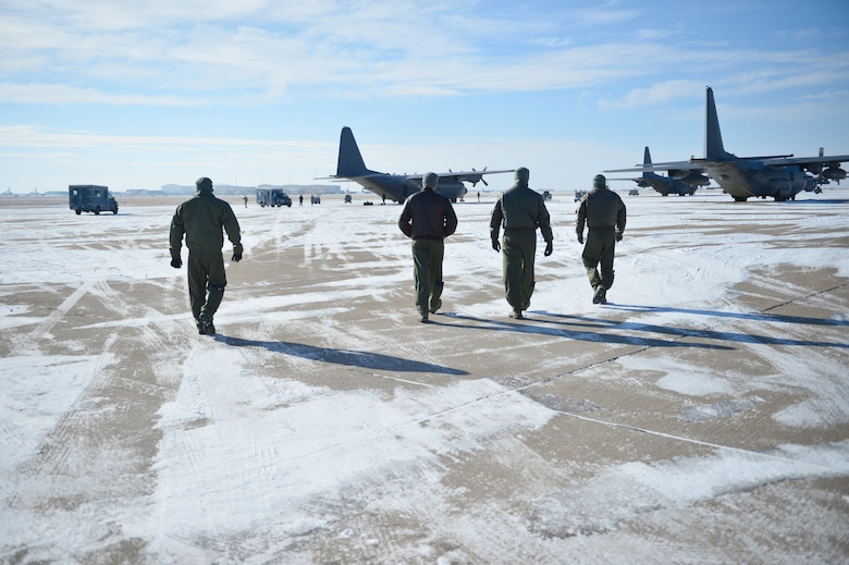 "Aircrew members from the 16 Special Operations Squadron walk toward the AC-130H Spectre gunship ""Bad Company"" on the flightline at Cannon Air Force Base, N.M., Feb. 7, 2014. Built in 1969, Bad Company is the first of six Spectre gunships scheduled to make the trip to Davis-Monthan Air Force Base, Ariz. (U.S. Air Force photo/ Senior Airman Eboni Reece)"