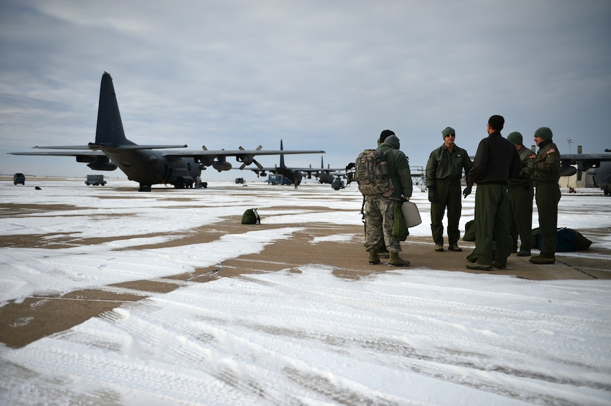 "Aircrew members from the 16th Special Operations Squadron await the take-off of the AC-130H Spectre gunship ""Bad Company"" on the flightline at Cannon Air Force Base, N.M., Feb. 7, 2014. Built in 1969, Bad Company is the first of six Spectre gunships scheduled to make the trip to Davis-Monthan Air Force Base, Ariz. (U.S. Air Force photo/ Senior Airman Eboni Reece)"