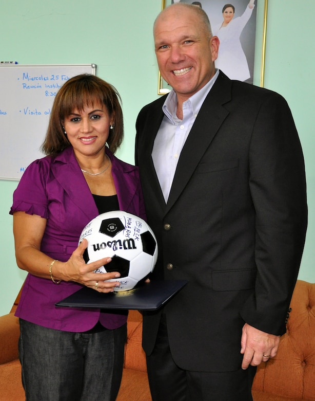 """U.S. Army Col. Thomas Boccardi, Commander, Joint Task Force-Bravo, presents a """"Kick for Nick"""" soccer ball to Gilma Castillo, Mayor of the city of La Paz, Honduras, Feb. 19, 2014.  Boccardi spent the day meeting with leaders of several communities surrounding Soto Cano Air Base.  During the meetings, Boccardi presented each leader with more than twenty soccer balls and a collection of soccer jerseys donated from the """"Kick for Nick"""" non-profit organization, which collects and distributes soccer balls for underprivileged children in honor of fallen U.S. Army Pvt. Nick Madaras, who was killed in Iraq in 2006."""