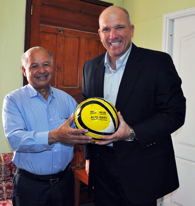 """U.S. Army Col. Thomas Boccardi, Commander, Joint Task Force-Bravo, presents a """"Kick for Nick"""" soccer ball to Ruben Raudales, Governor of the Department of La Paz, Honduras, Feb. 19, 2014.  Boccardi spent the day meeting with leaders of several communities surrounding Soto Cano Air Base.  During the meetings, Boccardi presented each leader with more than twenty soccer balls and a collection of soccer jerseys donated from the """"Kick for Nick"""" non-profit organization, which collects and distributes soccer balls for underprivileged children in honor of fallen U.S. Army Pvt. Nick Madaras, who was killed in Iraq in 2006."""