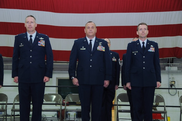 Col. Dar Craig, Lt. Col. Troy Drennan and Lt. Col. Jonathan Boyd stand at attention during a change of command ceremony held at the Utah Air National Guard Base in Salt Lake City, Utah, February 9, 2014.  The Base held five change of commands today. Drennan assumed command of the 169th Intelligence Squadron after Boyd relinquished command. (Utah Air National Guard photo by A1C Emily Hulse) (Released)