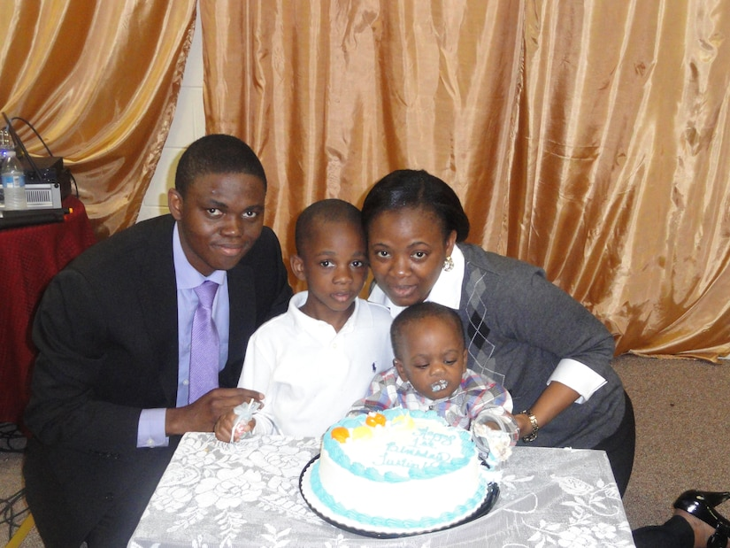 Petty Officer 2nd Class David Oba, his wife Oluwabunmi and their two sons, ...... (Courtesy photo)