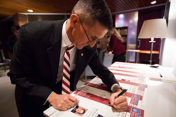 February 18th, 2014 - DIA Director Lt. Gen. Michael Flynn signs posters at Harvard Institute of Politics' John F. Kennedy Jr. Forum.