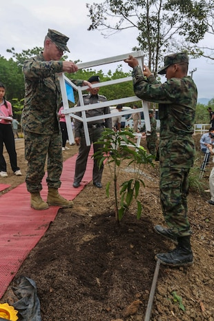 U.S. Navy Captain J.P. Hedges plants a tree at the Wat Kun Song school dedication ceremony during Exercise Cobra Gold in Chanthaburi Province, Kingdom of Thailand, Feb. 20. Cobra Gold, in its 33rd iteration, demonstrates the U.S. and the Kingdom of Thailand's commitment to our long-standing alliance and regional partnership, prosperity and security in the Asia-Pacific region. The building of the school is a combined effort between the Kingdom of Thailand, U.S., and Republic of Korea. Hedges is the division chaplain with Headquarters Battalion, 3d Marine Division, 3d Marine Expeditionary Force.
