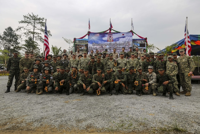 Royal Thai engineers, U.S. Navy Seabees, and Republic of Korea engineers pose for a photo at the Wat Kun Song school dedication ceremony during Exercise Cobra Gold in Chanthaburi Province, Kingdom of Thailand, Feb. 20. Cobra Gold, in its 33rd iteration, demonstrates the U.S. and the Kingdom of Thailand's commitment to our long-standing alliance and regional partnership, prosperity and security in the Asia-Pacific region. The building of the school is a combined effort between the Kingdom of Thailand, U.S., and Republic of Korea.