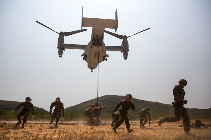 U.S. Marines evacuate the area as an MV-22B Osprey comes into land at Hat Yao, Kingdom of Thailand Feb. 18 during Exercise Cobra Gold 2014. Cobra Gold, in its 33rd iteration, is designed to advance regional security and ensure effective response to regional crises by exercising a robust multinational force from nations sharing common goals and security commitments in the Asia-Pacific region. The Marines are with 3rd Reconnaissance Battalion, 3rd Marine Division, III Marine Expeditionary Force and Headquarters Battalion, 3rd Marine Division, III Marine Expeditionary Force.