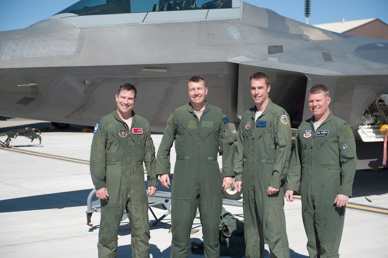 Major Jesse Colwell, F-22 Raptor pilot, Lt. Col. Shawn Anger, 7th Fighter Squadron commander, Capt. John Fischer, F-22 Raptor pilot, and Col. Andrew Croft, 49th Wing commander, stand in front of an F-22 at Holloman Air Force Base, N.M., Feb. 20. The 7th Fighter Squadron and members of the Holloman community celebrated this sortie before the F-22s depart for Tyndall Air Force Base, Fla., in early April. (U.S. Air Force photo by Airman 1st Class Daniel Liddicoet/Released)