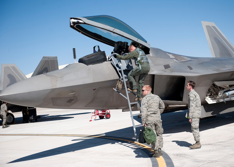 Colonel Andrew Croft, 49th Wing commander, exits an F-22 Raptor after his final flight in this aircraft at Holloman Air Force Base, N.M., Feb. 20. The 7th Fighter Squadron and members of the Holloman community celebrated this sortie before the F-22s depart for Tyndall Air Force Base, Fla., in early April. (U.S. Air Force photo by Airman 1st Class Daniel Liddicoet/Released)