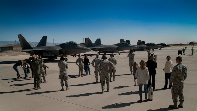 Four F-22 Raptors park after flying their final four-ship tactical sortie at Holloman Air Force Base, N.M., Feb. 20. The 7th Fighter Squadron and members of the Holloman community celebrated this sortie before the F-22s depart for Tyndall Air Force Base, Fla., in early April. (U.S. Air Force photo by Airman 1st Class Aaron Montoya / Released)