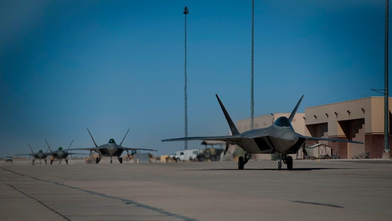 Four F-22 Raptors return from the final four-ship tactical sortie flown at Holloman Air Force Base, N.M., Feb. 20. The 7th Fighter Squadron and members of the Holloman community celebrated this sortie before the F-22s depart for Tyndall Air Force Base, Fla., in early April. (U.S. Air Force photo by Airman 1st Class Aaron Montoya / Released)