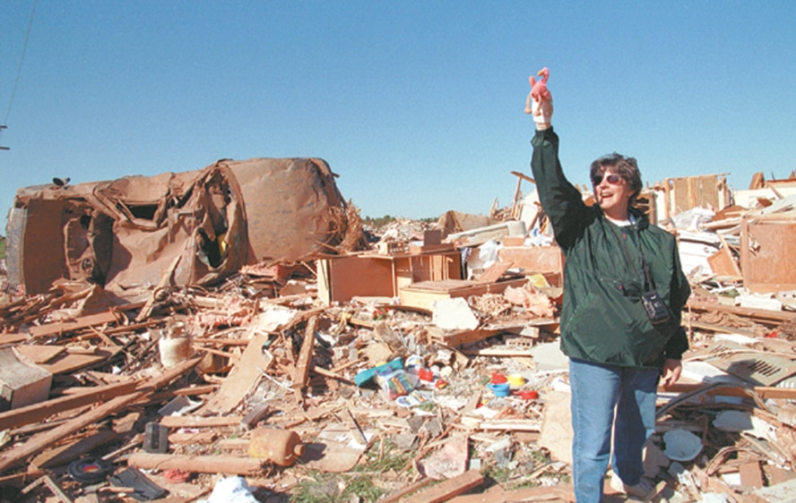 Searching through the rubble that once was her house, Becky Pillifant finds a stuffed flamingo that had been in her car before a tornado ripped through Moore and south Oklahoma City on May 3, 1999. Ms. Pillifant, a marketing specialist in the 72nd Force Support Squadron, said she has the flamingo in a shadowbox in the kitchen of her new home, which was built in the same spot as the one destroyed in 1999. (Air Force photo by Margo Wright)