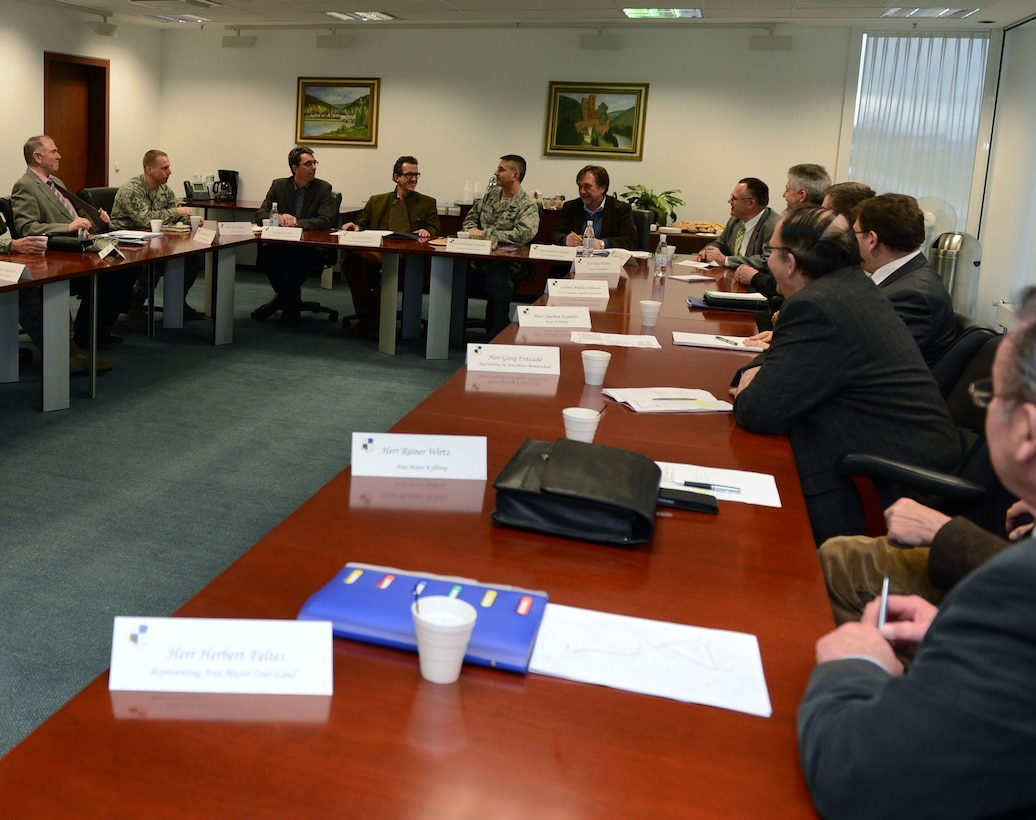 Col. David Julazadeh, 52nd Fighter Wing commander, seated center right at back table, talks with key leaders from the German community at Spangdahlem Air Base, Germany, Feb. 19, 2014. The information forum created opportunities for community leaders to voice their opinions and concerns while gathering insight on current events and operations. (U.S. Air Force photo by Airman 1st Class Kyle Gese/Released)