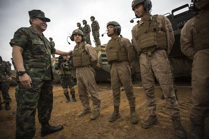 Royal Thai General Thanasaka Patimaprakorn speaks with U.S. Marines after the completion of a combined live-fire exercise during the conclusion of exercise Cobra Gold 2014 in Royal Thai Navy Tactical Training Center Ban Chan Krem, Chanthaburi, Kingdom of Thailand, Feb. 21. Cobra Gold, in its 33rd iteration, demonstrates the U.S. and the Kingdom of Thailand's commitment to our long-standing alliance and regional partnership, prosperity and security in the Asia-Pacific region. (U.S. Marine Corps photo by Sgt. Matthew Troyer/Released)
