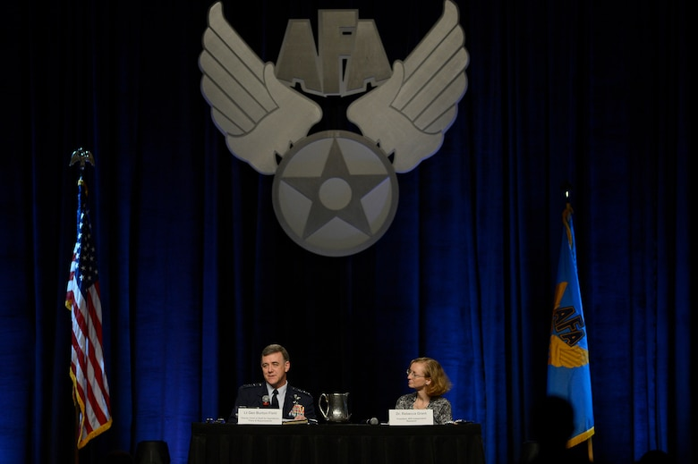 "Lt. Gen. Burton Fields (left) and Dr. Rebecca Grant talk about new capabilities during their, ""The Future Bomber,"" discussion at the 30th Annual Air Force Association Air Warfare Symposium and Technology Exposition in Orlando, Fla., Feb. 20, 2014.  Field said as the technological climate of war advances, the new long-range strike bomber will need the capability to combat new threats. Field is the deputy chief of staff for operations, plans and requirements. Grant is the president of  IRIS Independent Research. (U.S. Air Force photo/Scott M. Ash)"