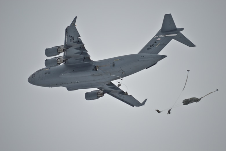 Paratroopers from the 4/25th IBCT jump from a C-17 Globemaster III Feb. 17, 2014, into Malemute Drop Zone at Lop Buri, Kingdom of Thailand, as part of Exercise Cobra Gold.  Cobra Gold, an annual exercise providing tactical, humanitarian and civil assistance, brings together multiple nations cooperating in areas of common interest to support the security and stability of the Asia-Pacific region. (Courtesy photo)