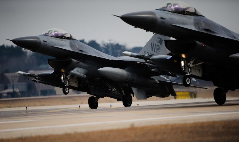 Two F-16 Fighting Falcons from the 35th Fighter Squadron land in sync after a training sortie Feb. 13, 2014, at Kunsan Air Base, South Korea. The pilots faced different training scenarios to further reinforce their ability to fight off aggressors. (U.S. Air Force photo/Senior Airman Armando A. Schwier-Morales)