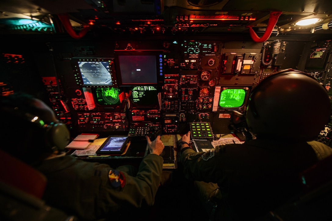 Capt. Zachary Proano (left) and Capt. Andrew Parlsen conduct a training mission on a B-52H Stratofortress Feb. 11, 2014, over Nevada. The 23rd Bomb Squadron conducted a live ordnance training mission dropping Cluster Bomb Unit 103 and CBU-87 at the Nevada Test and Training Range. Proano is a 23rd BS radar navigator and Parlsen is a 23rd BS Navigator. (U.S. Air Force photo/ Staff Sgt. Jonathan Snyder)