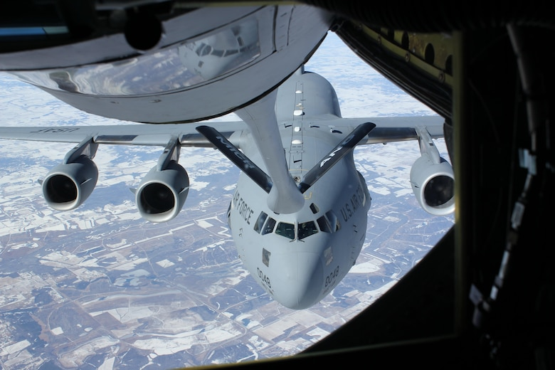 A C-17 Globemaster III moves into position behind a KC-135 Stratotanker for an in-flight refueling Feb. 13, 2014, over southern Kentucky. The C-17 is from the from the 445th Airlift Wing, an Air Force Reserve Wing based at Wright-Patterson Air Force Base, Ohio. The KC-135 is from the Michigan Air National Guard's 127th Wing and operates out of Selfridge Air National Guard Base, Mich. (U.S. Air National Guard photo/Tech. Sgt. Dan Heaton)