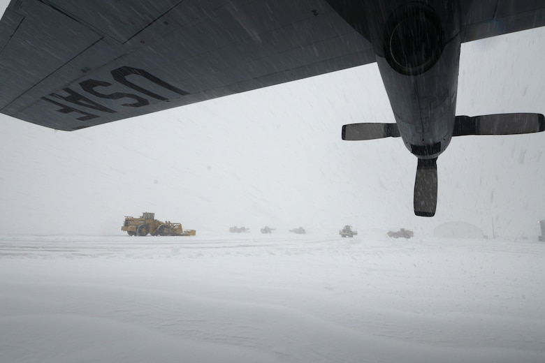 A C-130H Hercules assigned to the 103rd Airlift Wing weathers the storm Feb. 13, 2014, at Bradley Air National Guard Base, East Granby, Conn. More than a half dozen machines from the adjacent Bradley International Airport worked to clear the rapidly accumulating snow from the aircraft ramp. (U.S. Air National Guard photo/Master Sgt. Erin McNamara)